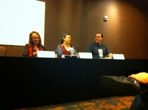 "Maya Kaathryn Bohnhoff, Jennifer Carson, and Kyle Aisteach speaking at the panel on ""Listening to That Critique"""